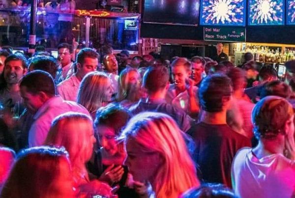 Bar-goers at night.